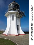 Small photo of Cape Reinga, Northland, New Zealand, white lighthouse stands tall on the coast.