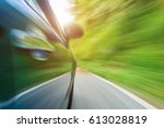blurred motion car moves at... | Shutterstock . vector #613028819