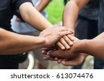 hands assemble teamwork... | Shutterstock . vector #613074476