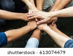 group of people united hands to ... | Shutterstock . vector #613074479