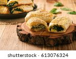 puff pastry rolls  with spinach ... | Shutterstock . vector #613076324