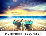 couple on the beach at tropical ... | Shutterstock . vector #613076519