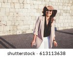young stylish woman wearing... | Shutterstock . vector #613113638