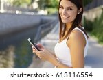 attractive smiling woman... | Shutterstock . vector #613116554