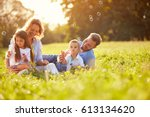 children in green nature make... | Shutterstock . vector #613134620