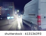 Delivery van drives at night in ...
