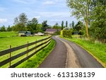 village road in rural area... | Shutterstock . vector #613138139