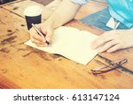 close up of males hand writing... | Shutterstock . vector #613147124