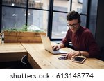 confident busy male freelancer... | Shutterstock . vector #613148774