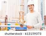 a young indian engineer holding ... | Shutterstock . vector #613159373