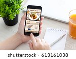 women hand holding phone with... | Shutterstock . vector #613161038