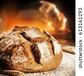 freshly baked bread in rustic... | Shutterstock . vector #613161293