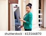 asian lady using an automated... | Shutterstock . vector #613166870