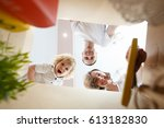 happy smiling young family with ... | Shutterstock . vector #613182830