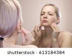 girl looks in the mirror  not... | Shutterstock . vector #613184384