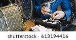 jeweler examining diamond... | Shutterstock . vector #613194416