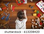 little boy lying on the wooden...   Shutterstock . vector #613208420