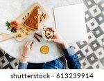 breakfast in the cafe. a girl... | Shutterstock . vector #613239914