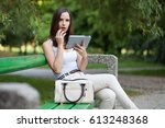 young woman on video call using ... | Shutterstock . vector #613248368