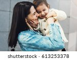 fun beautiful woman and toddler ... | Shutterstock . vector #613253378