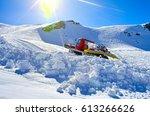 snowcat on slope | Shutterstock . vector #613266626