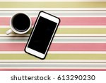 a cup of coffee and a smart... | Shutterstock . vector #613290230