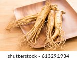 fresh ginseng root over wooden