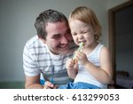 father and his young son... | Shutterstock . vector #613299053