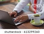 young man working on his laptop ... | Shutterstock . vector #613299260