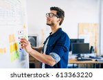 ux specialist designing new... | Shutterstock . vector #613363220