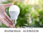 woman hand is holding led bulb...   Shutterstock . vector #613363226