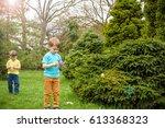 kids on easter egg hunt in... | Shutterstock . vector #613368323