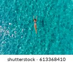 top view of lonely woman in a... | Shutterstock . vector #613368410
