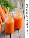 fresh carrot juice in a bottles ...