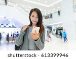 woman working on smart phone in ... | Shutterstock . vector #613399946