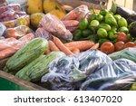 vegetables on a street market... | Shutterstock . vector #613407020