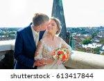 groom kisses bride's cheek...   Shutterstock . vector #613417844