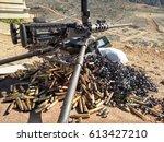 50 Cal Machine gun with spent brass around it