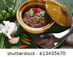 shrimp paste sauce in a ceramic ... | Shutterstock . vector #613435670