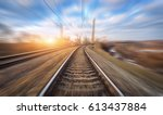 railroad in motion at sunset.... | Shutterstock . vector #613437884
