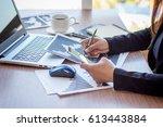 close up businessmen working at ... | Shutterstock . vector #613443884