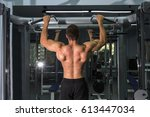 a man with an inflated back... | Shutterstock . vector #613447034