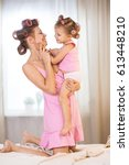 mom and daughter in curlers in... | Shutterstock . vector #613448210