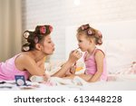 mom and daughter in the bedroom ... | Shutterstock . vector #613448228