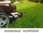 Lawn mower on green grass