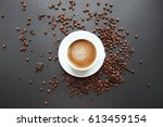 cappuccino cup and coffee beans ... | Shutterstock . vector #613459154