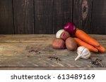 vegetables on vintage wooden... | Shutterstock . vector #613489169
