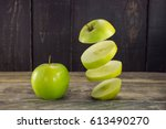 sliced apple floats in the air ... | Shutterstock . vector #613490270
