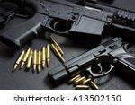 handgun with rifle over dark... | Shutterstock . vector #613502150