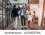 high five   full length of two... | Shutterstock . vector #613503704